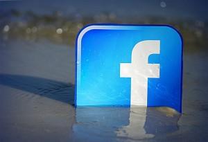 facebook logo at the beachfront